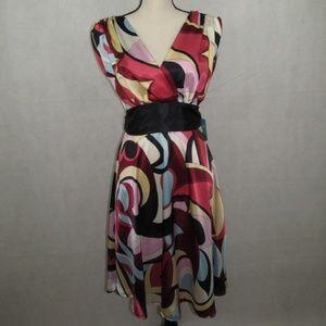 Roulette Dress V Neck Size 6 Sash Flower Design